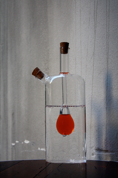 --- bottle-with-red-liquid